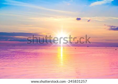 Nightfall by the Sea Sun Setting  - stock photo