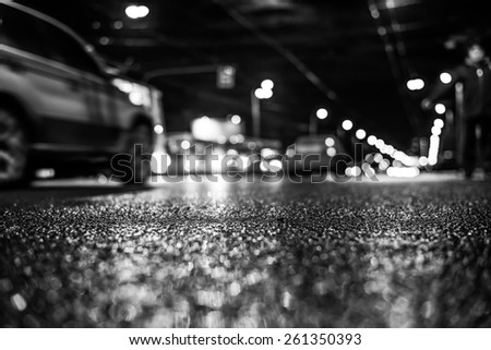 Nightlife, man catches a taxi voting on the sidelines. In black and white tones - stock photo
