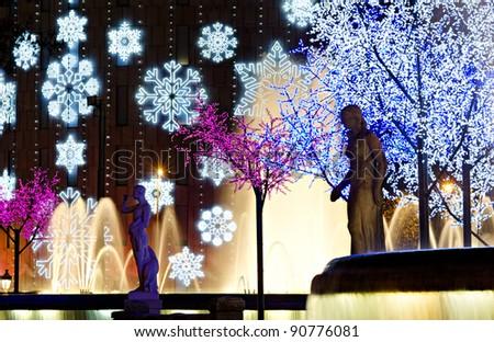 nightly colorful christmas illumination, Plaza Catalunya, Barcelona, Spain - stock photo