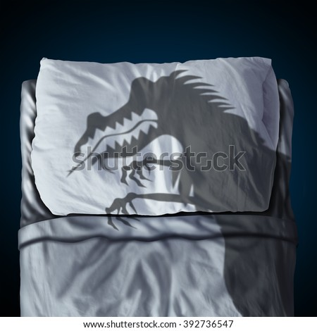 Nightmare and scary night dream concept as a cast shadow of a creepy monster on a bed with a pillow on a mattress as a symbol of childhood sleep anxiety or bedtime stress. - stock photo