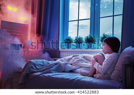Nightmare for children. Little child girl is afraid of monsters in the dark of night.  - stock photo