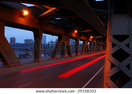 Nightshot of light tracks of cars in high level bridge, city edmonton, alberta, canada - stock photo