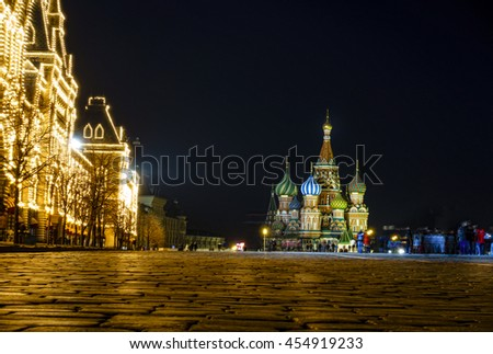 Nighttime view of TsUM Department Store and St. basil Cathedral on the Red Square in Moscow, Russia - stock photo
