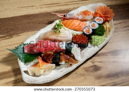 Nigiri sushi set with variety favorite raw seafood ingredients Salmon , Makuro , Grilled Unagi (eel), Ebiko and Hokkigai - Japanese traditional food - stock photo