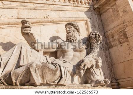 Nile River god statue with Cornucopia, at Palazzo Senatorio. Capitoline square in Rome - stock photo