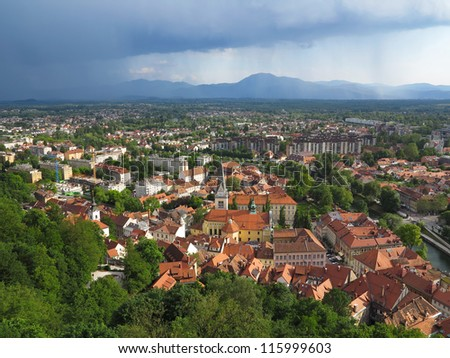 Nimbostratus clouds over the Capital City Ljubljana in Slovenia - stock photo