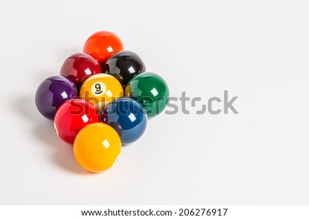 Nine Ball racked in a diamond shape on a plain white background left side. - stock photo