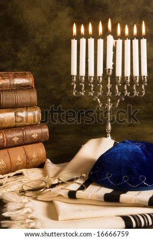 Nine candles for Hanukkah, and a prayer shawl - stock photo