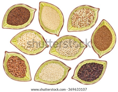 nine gluten free grains (black quinoa, buckwheat, amaranth, teff, sorghum, kaniwa, millet, and brown rice) - top view of leaf shaped ceramic bowls isolated on white - stock photo
