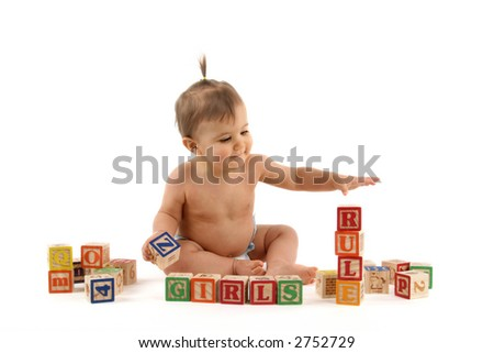 nine month old baby girl playing with blocks - stock photo