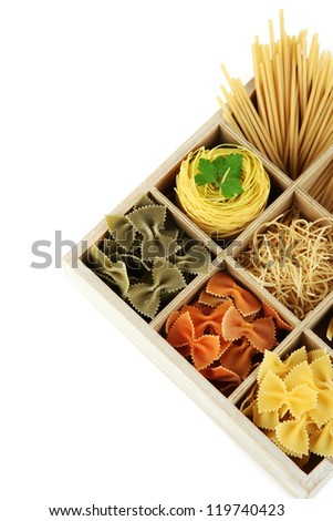 Nine types of pasta in wooden box sections close-up isolated on white - stock photo