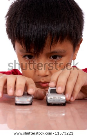 nine year old boy playing toy car - stock photo