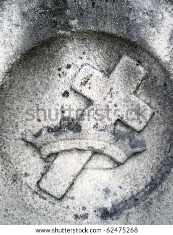 Nineteenth century gravestone detail cross and crown - stock photo