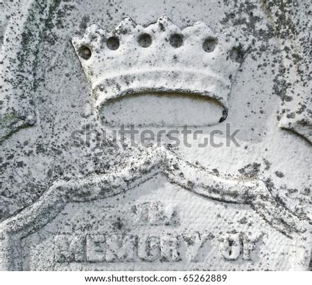 Nineteenth century gravestone detail crown bas-relief - stock photo