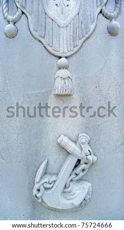 Nineteenth century white bronze gravestone anchor and drapes - stock photo