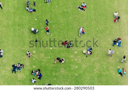 Ninety degrees view of people relaxing on a meadow. - stock photo