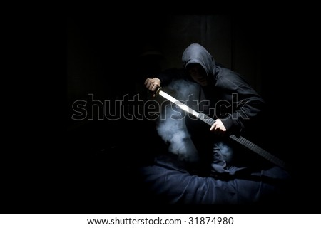 Ninja with sword at night in smoke - stock photo