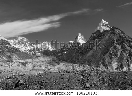 Nirekha (6169 m), Kangchung (6062 m), and Chola (6069 m) in the area of Cho Oyu - Gokyo region, Nepal (black and white) - stock photo