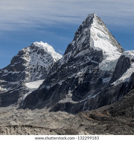 Nirekha (6169 m), Kangchung (6062 m) and Moon betwen them - Gokyo region, Nepal - stock photo
