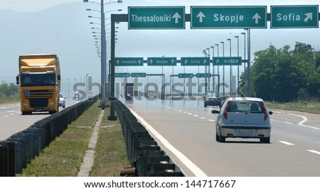 NIS, SERBIA - CIRCA JUNE 2006: Vehicles passes by highway E-75 on corridor 10 thru Serbia circa June 2006 in Nis - stock photo