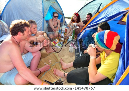 NITZANIM, ISR - APR  01:Israeli youth in Boombamela festival on April 01 2010.It's a Shanti/New Age festival held annually in Israel since 1999 based on the Hindu festival of Kumbh Mela in India. - stock photo