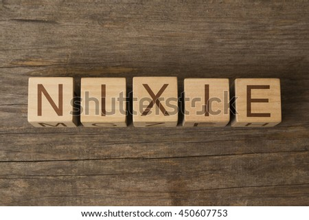 NIXIE word on wooden cubes - stock photo