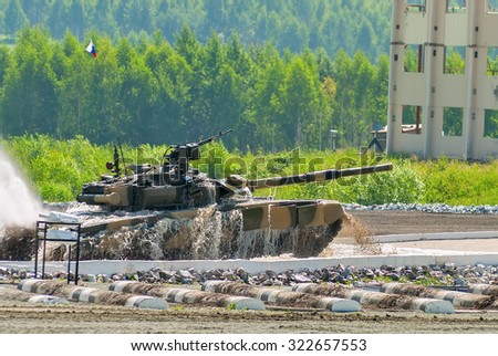 Nizhniy Tagil, Russia - July 12. 2008: Modernized tank T-80 moves after overcoming of water of 1.5 meters in depth - stock photo