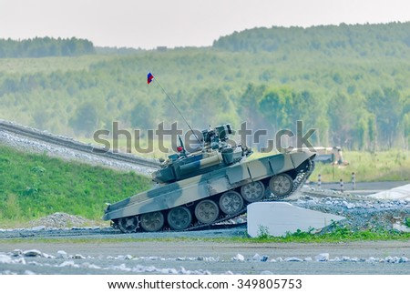 Nizhniy Tagil, Russia - July 12. 2008: Russian military tank T-80 with obstacle overcoming. RAE exhibition - stock photo