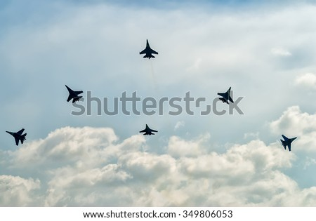 Nizhniy Tagil, Russia - July 12. 2008: Team work of russian fighters SU-27 knights. Display of fighting opportunities of equipment with application of aviation means of defeat. RAE exhibition - stock photo