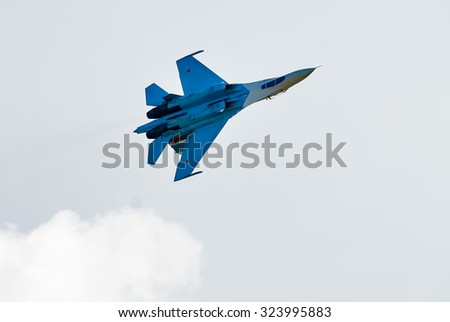 Nizhniy Tagil, Russia - July 12. 2008: Work of russian fighter SU-27 knight. Upside down flight. Display of fighting opportunities of equipment. RAE exhibition  - stock photo