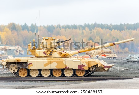 Nizhniy Tagil, Russia - September 25. 2013: Modernized tank T-90s. It moves on the shooting demonstration range. Russia Arms Expo-2013 exhibition - stock photo
