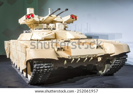 "Nizhniy Tagil, Russia - September 27. 2013: Tank Support Fighting Vehicle (BMPT-72) ""Terminator-2"" in closed presentation pavilion. RAE-2013 exhibition (Russia Arms Expo-2013) - stock photo"
