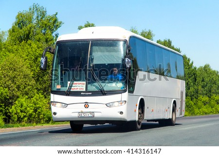 NIZHNY NOVGOROD REGION, RUSSIA - MAY 21, 2013: Intercity coach bus Marcopolo Andare 850 at the interurban freeway. - stock photo