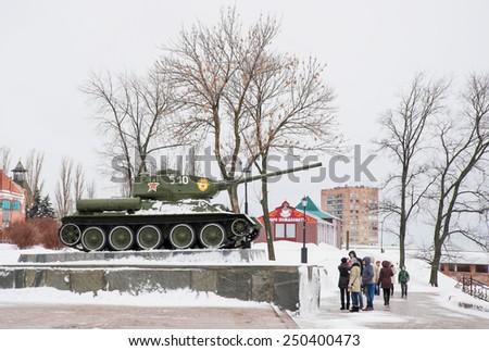 Nizhny Novgorod, Russia - January 03: People looking at soviet military panzer in Nizhny Novgorod, Russia on January 03, 2015. TheT-34�was a Soviet medium tank widely used during World War II - stock photo