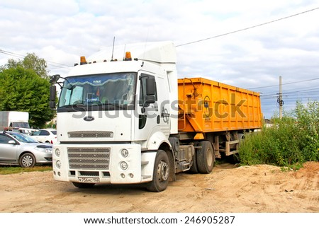 NIZHNY NOVGOROD, RUSSIA - JULY 26, 2014: White semi-trailer truck Ford Cargo 1838T at the city street. - stock photo
