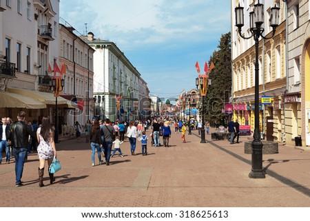 Nizhny Novgorod, Russia - May 2, 2015: Bolshaya Pokrovskaya street. A pedestrian street, the main street of the city. Street vendors, souvenirs, shops and main restaurants, and several museums - stock photo