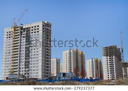 NIZHNY NOVGOROD, RUSSIA - MAY 7: New residential complex under construction on May 7, 2015 in Nizhny Novgorod. - stock photo