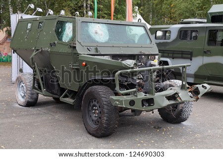NIZHNY TAGIL, RUSSIA- AUG 24: The armored car after the trials of fire and explosion at exhibition RUSSIAN DEFENCE EXPO 2012 on August, 24, 2012 at Nizhny Tagil, Russia - stock photo