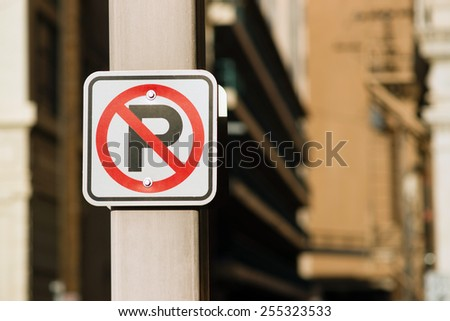 No Auto Parking Sign Bolted to Light Post Downtown - stock photo
