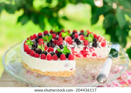 No-bake Fresh Raspberry Cheesecake with Red and Black Raspberries and Melissa, Summer Cake - stock photo