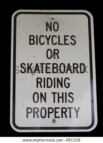 No bikes or skateboards on property sign - stock photo