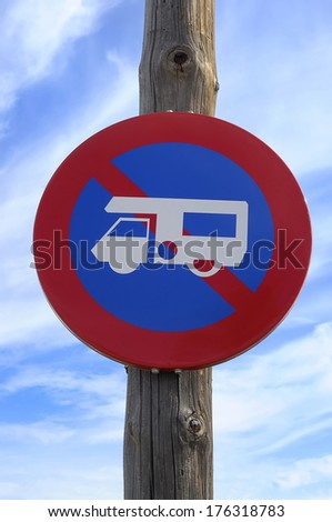 No campervans or motorhomes sign on a beach. Taken against a blue summer sky. - stock photo