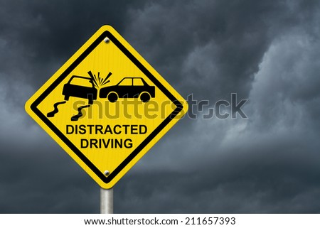 No Distracted Driving Sign, Yellow warning sign with words Distracted Driving and accident icon with stormy sky background - stock photo