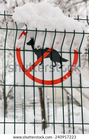 No dogs allowed sign on a fence in winter - stock photo