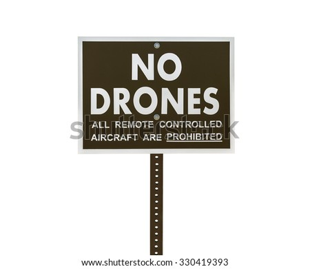 No drones all remote controlled aircraft are prohibited sign isolated with clipping path. - stock photo