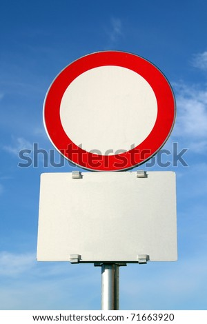No entry sign against blue sky - stock photo
