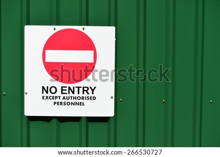 No Entry Sign On  A Green Corrugated Sheets Fencing - stock photo