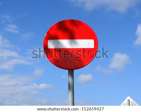 No entry traffic sign with blue sky background. - stock photo