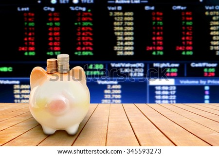 no face piggy bank on perspective floor with blur stock market number background - stock photo