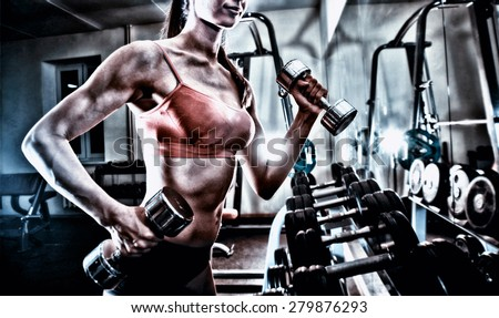 no face Unrecognizable person fitness girl do exercise with dumbbells in gym near shelf and mirror reflection Brutal athletic woman pumping up muscles with bells. sexy fitness girl in pink sport wear  - stock photo